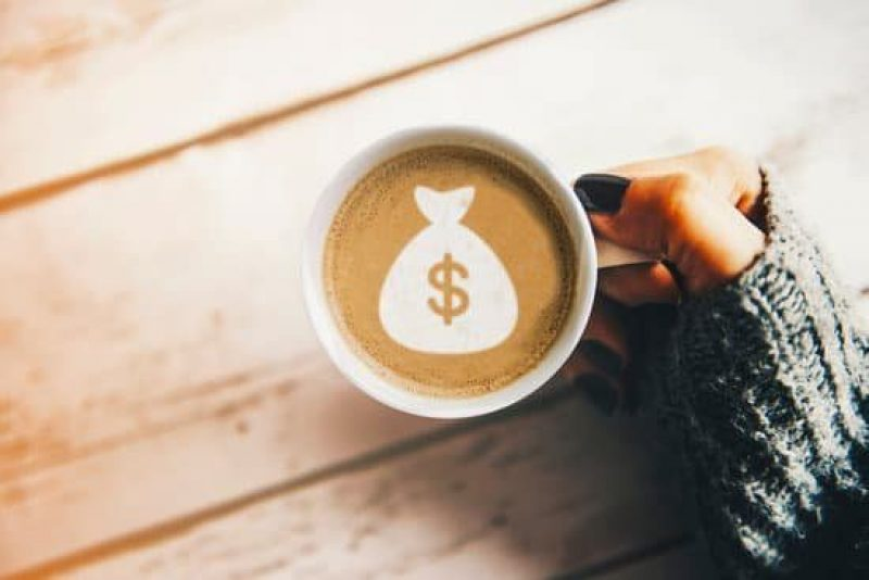 Money image in cup of coffee